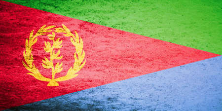 '5 december': The flag of Eritrea was adopted on December 5, 1995. It bears a resemblance to the official flag of the Eritrean Peoples Liberation Front. The wreath with the upright olive branch symbol was derived from the 1952 flag, which had a light blue background t
