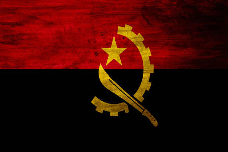 upper half: The national flag of Angola came into use at independence on November 11, 1975. It is split horizontally into an upper red half and a lower black half, and features a yellow half-gear crossed with a machete and crowned with a star.