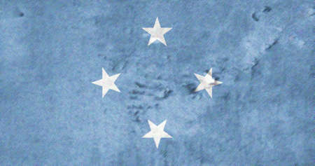 pacific ocean: The flag of the Federated States of Micronesia FSM was adopted on 30 November 1978. The blue field represents the Pacific Ocean, while the four stars represent the states in the federation: Chuuk, Pohnpei, Kosrae and Yap.The flag, adopted in 1978 is in th Stock Photo