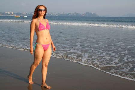 Beautiful young woman on beach photo