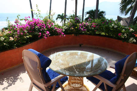 balcony: Beautiful balcony with flowers looking at ocean Stock Photo