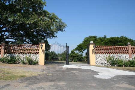 main gate: Iron gate to large estate Stock Photo