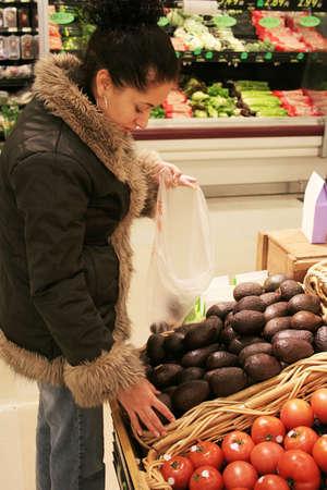 Woman shopping in supermarket Фото со стока