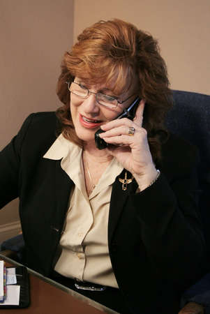 woman on phone: Senior Executive Woman talking on cell phone