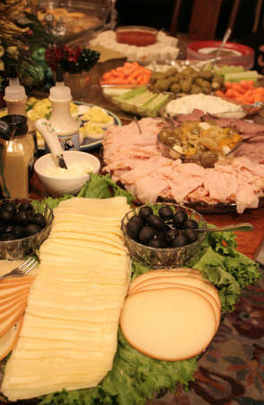 amounts: Large amounts of delicious food on table Stock Photo