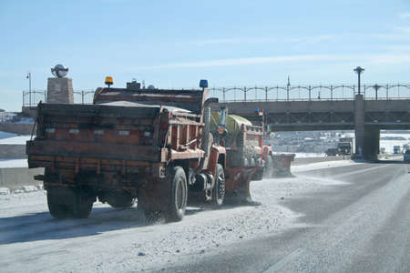 Snow plows on interstate photo