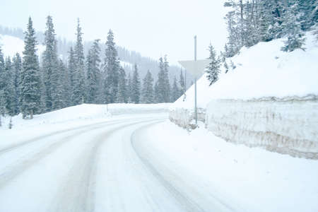 Snowy mountain highway with curve photo