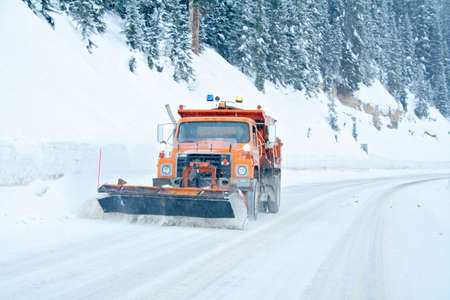 Snow plow removing snow from mountain highway Stock Photo - 2464285