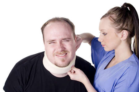 Nurse applying neck brace on man in pain photo