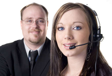 Young woman with headset and man in background on white photo