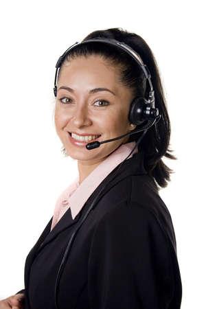 Pretty hispanic woman with headset smiling Фото со стока