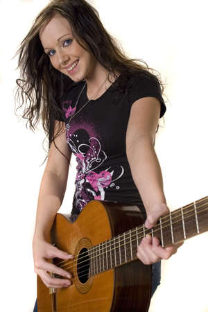 Pretty young rocker girl with guitar