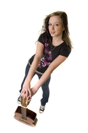 rocker girl: Pretty chica joven rockero con guitarra  Foto de archivo