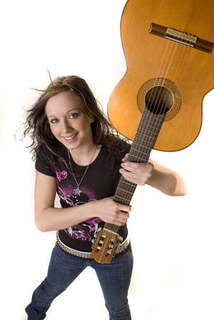 Pretty young rocker girl with guitar photo