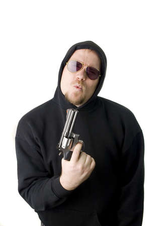 Criminal or Gangster with revolver and dark glasses photo