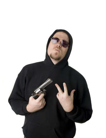 Criminal or Gangster with revolver and dark glasses Stock Photo - 2770973
