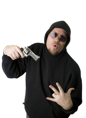 Criminal or Gangster with revolver and dark glasses Stock Photo - 2770985