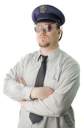 response: Police Officer with dark glasses standing looking menacing