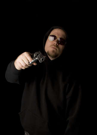 Criminal or Gangster with revolver and dark glasses Stock Photo - 2770964