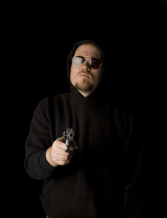 Criminal or Gangster with revolver and dark glasses Stock Photo - 2770963
