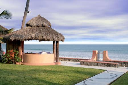 cabana: Beautiful beach cabana overlooking ocean in grassy yard Stock Photo