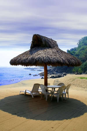 small beach cabana next to sea shore photo