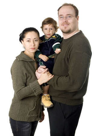 Interacial couple with small  boy smiling isolated 스톡 콘텐츠