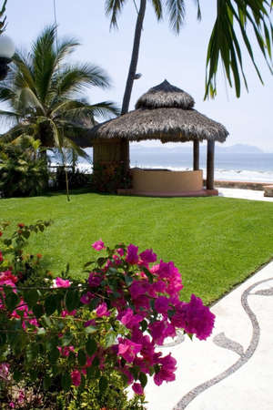 shady: Beautiful Cabana surounded by flowers and ocean