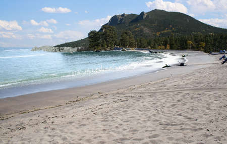 beautiful beach with mountain and pine trees Stok Fotoğraf