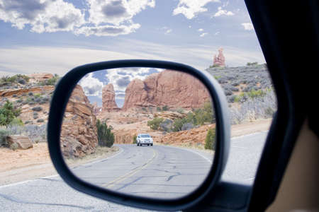 rear view mirror view of Arches area mountains and spires in Utah USA