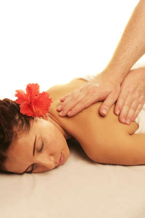 Young woman on a white massage table in a spa treatment Stock Photo