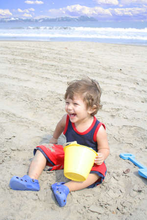 Young child playing in the sand on the beach