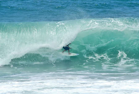 surfer getting tubed in a perfect wave Stock Photo - 3358121