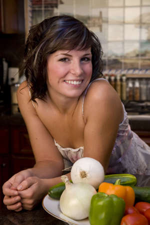 A young woman portrait in the kitchen Stock Photo - 3747193