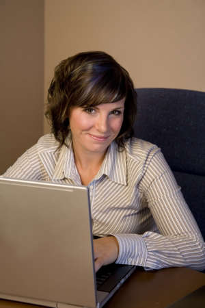 A young professional woman working on a laptop Stock Photo - 3747218
