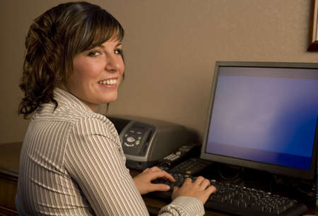 A cute young professional working on the computer Stock Photo - 3747195