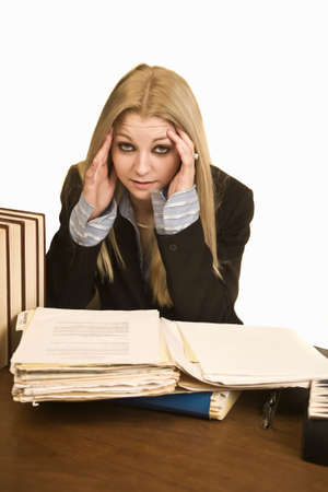 Stressed out business woman at desk Stock Photo - 3795025
