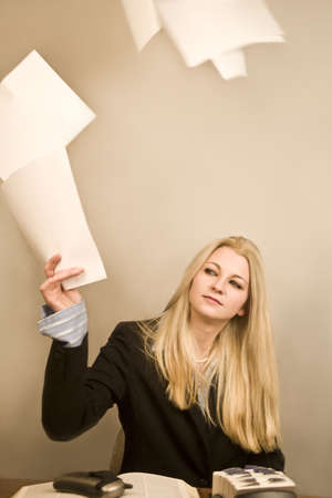 paper sheet: young tired business woman throwing papers into the air