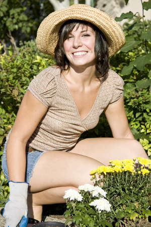 Beautiful young woman in the yard gardening Stock Photo - 3975858