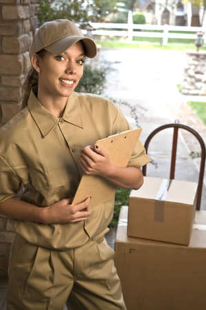 Young woman delivering shipment or package at door