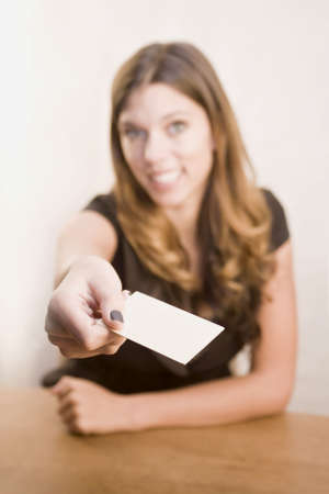 business cards: A young woman giving over her business card