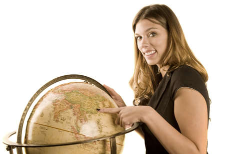 A young woman pointing at a globe Stock Photo - 4087483