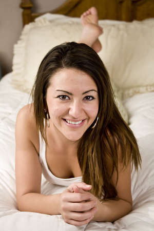 Woman laying in bed relaxing and smiling Stock Photo - 4088478