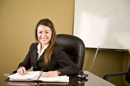 A young professional business woman working at her desk Stock Photo - 4088470