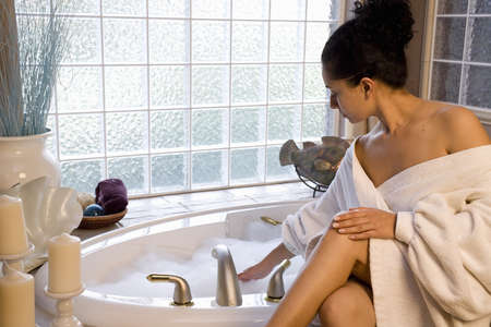 A beautiful young woman taking a bubble bath