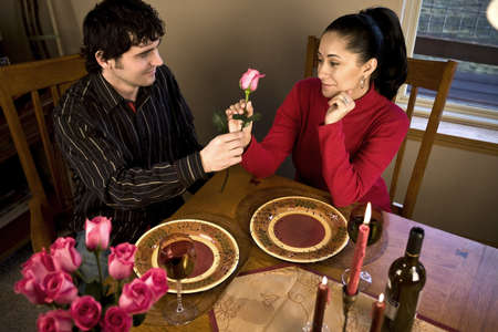 candle: A young couple having a romantic candle light dinner