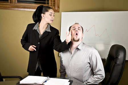 Woman slapping a co-worker in a meeting because of harassment photo