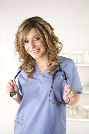 Beautiful young nurse on white hospital background Stock Photo - 4335530