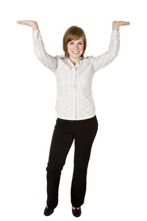 Business woman holding or lifting something above her head photo
