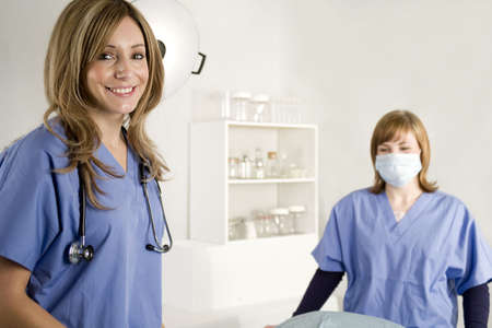 surgical light: Nurse and doctor in a hospital surgical room  Stock Photo